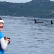 orca-camp-1346-taking-photo-from-beach-killer-whales